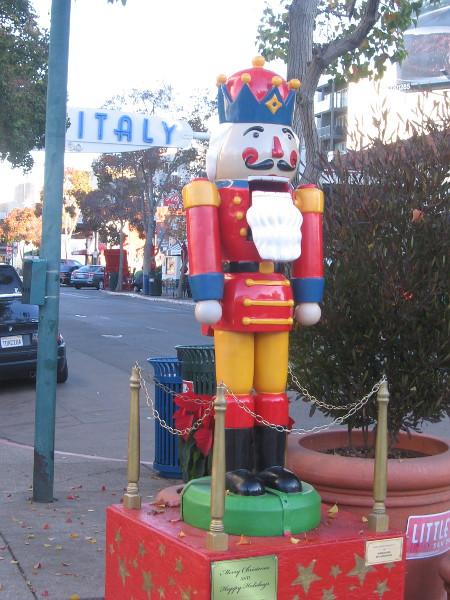 A colorful nutcracker on India Street near the Little Italy landmark sign.