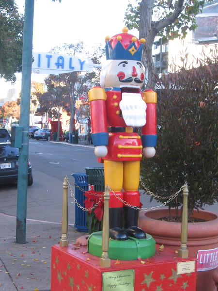 A colorful nutcracker on India Street near the Little Italy landmark sign.