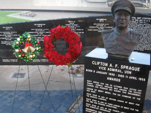 The bust of Vice Admiral Clifton Sprague, and two holiday wreaths, on The Greatest Generation Walk in San Diego.