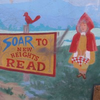 Books fly in a children's reading mural!