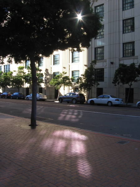 A splash of light from windows across Kettner Boulevard.