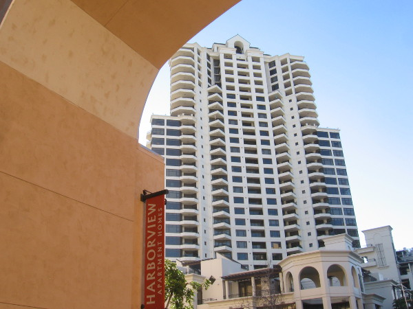 The distinctive Park Place condo building appears through an archway.