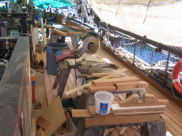 The main deck of HMS Surprise is full of lumber, saws and other woodworking tools!