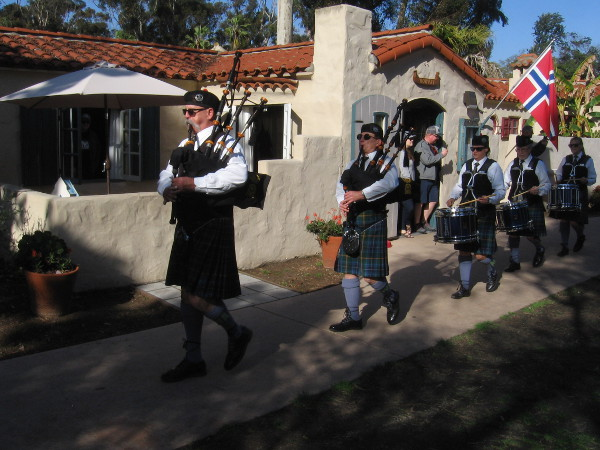 The House of Scotland Pipe Band marches musically to the stage during the HPR Entertainment Sampler.