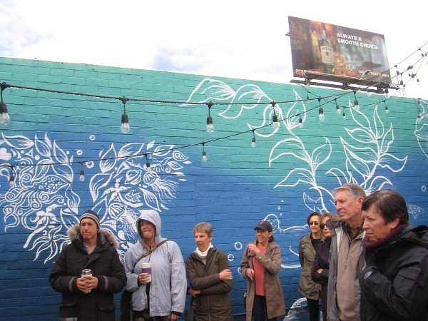 We learn about the history of murals beside the work of muralist Jared Blake Lazar.