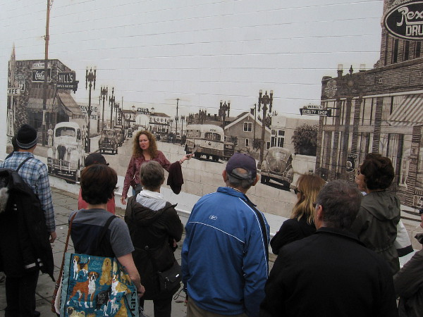 Our group meets muralist Kathleen King, whose 1988 mural was painted from a 1943 photo of Garnet Avenue, looking west toward Crystal Pier.
