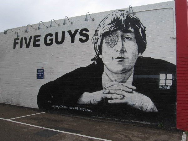 A cool John Lennon mural on the side of Five Guys was painted in 2006 by Steve Gorrow, Creative Director of Insight Clothing.