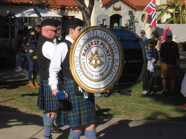 The big, booming House of Scotland Pipe Band drum keeps rhythm with the assembled bagpipers.
