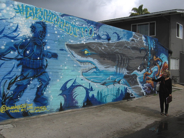 Learning about one of Pacific Beach's many amazing, colorful murals during a guided walk!