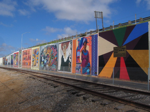 A row of bold murals that represent different art styles through history.