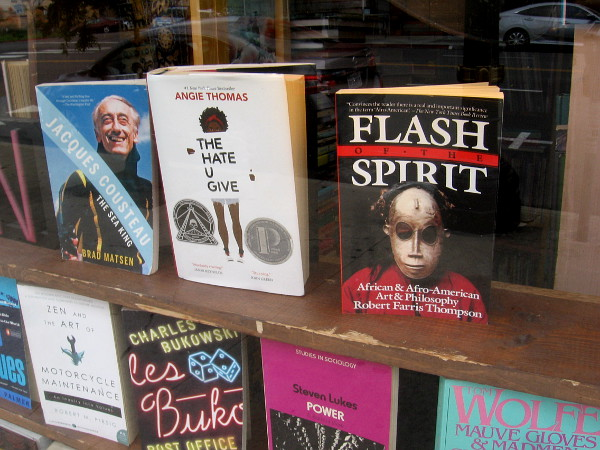 Human thought and endeavor endure in a bookstore window.