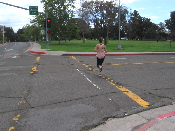 A lone jogger heads south down quiet Park Boulevard.