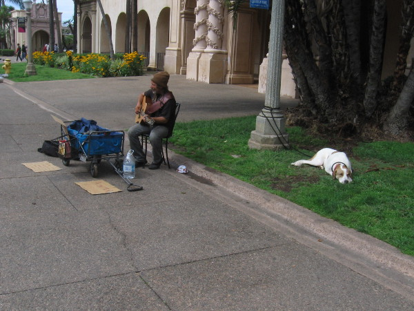 A street performer and his dog on Balboa Park's normally busy El Prado.