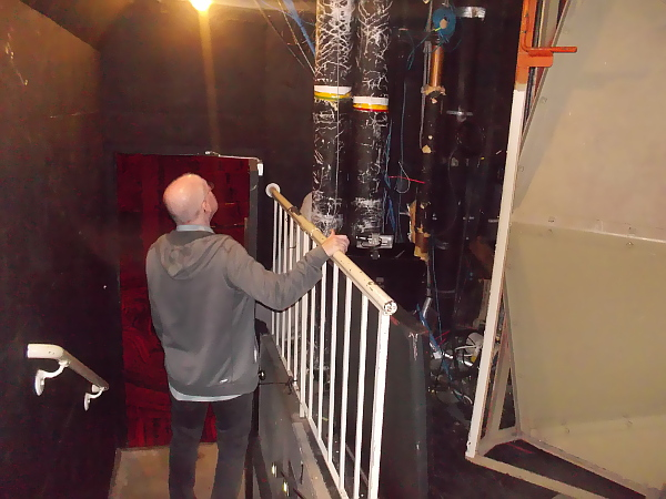 A glimpse of the gritty inner workings of a major theatre, tucked between the audience and the stage.