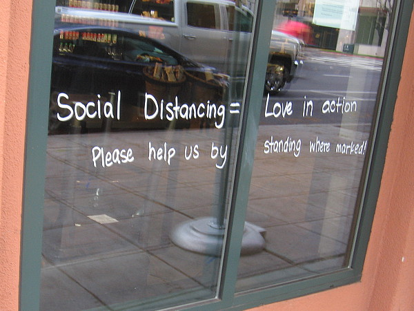 In one window: Social distancing equals love in action.