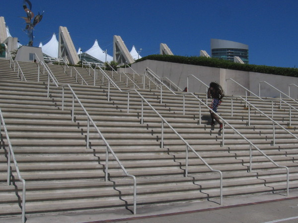 An athlete trains by running up and down the steps of the San Diego Convention Center.
