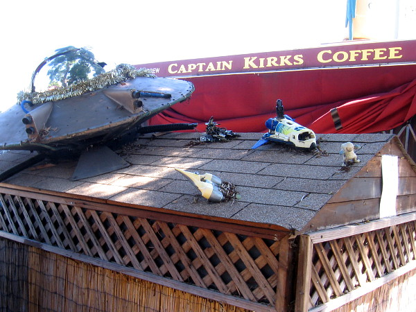 Various spaceships have landed or crashed atop the roof of Captain Kirk's Coffee.