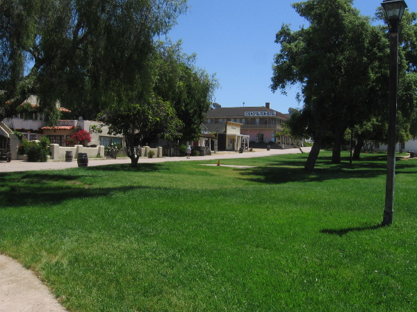 The plaza in the middle of Old Town San Diego State Historic Park is deserted. But the grass is long and green!