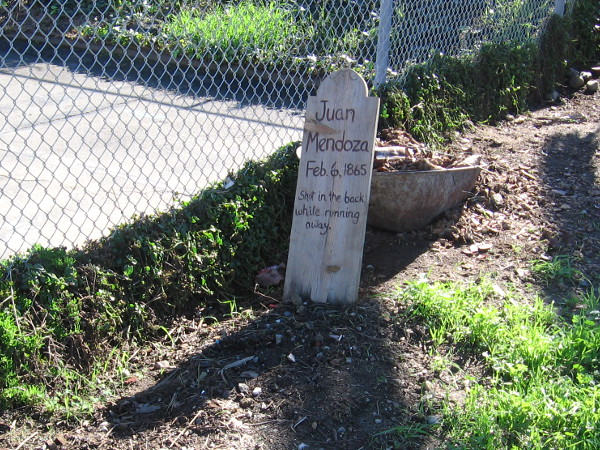 Mysterious wooden tombstone with name of Juan Mendoza, who was shot by Cave Couts in the back with a double-barreled shotgun in Old Town San Diego, February 6, 1865.