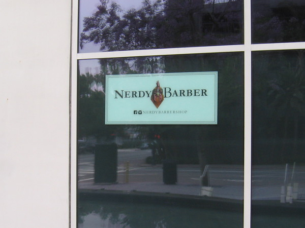 In a window: Nerdy Barber.