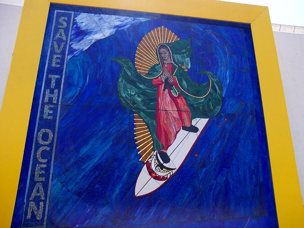 The Surfing Madonna and a prayerful message. Save the Ocean.