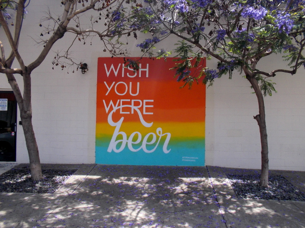 Graphic on wall of Coronado Brewing Company San Diego Tasting Room. WISH YOU WERE beer.