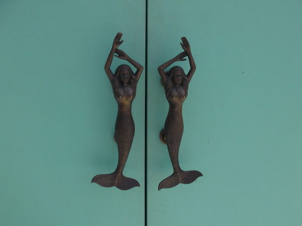 Mermaid door handles at the entrance to The Cordova Bar.