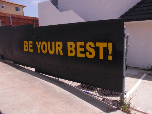 Sign on fence near U.S. Karate Academy encourages people to Be Your Best!