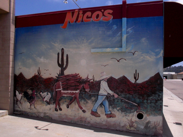 A colorful mural near the front door of Nico's Mexican Food.