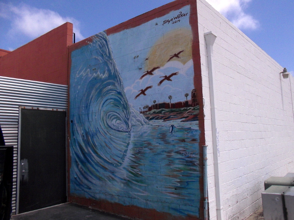 Mural at Bird's Surf Shed was painted by Skye Walker in 2014.