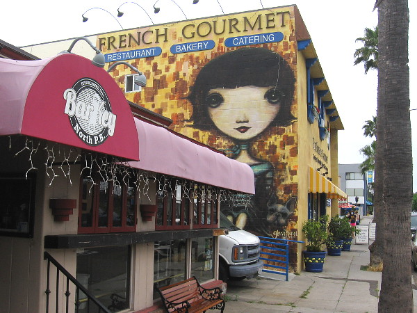 A large face greets those heading east on Turquoise Street in Pacific Beach.
