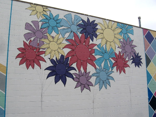 These colorful flowers are at the center of the mural.