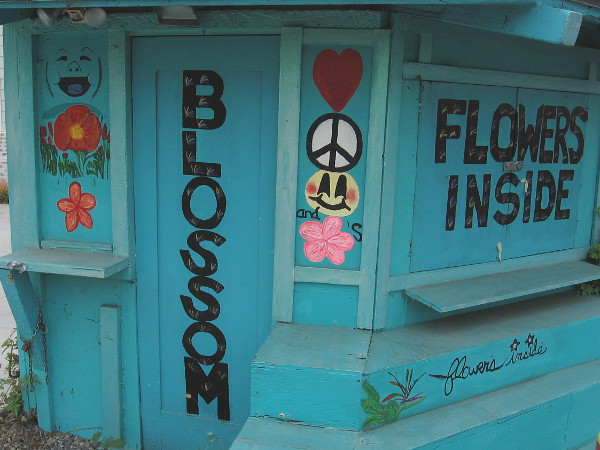 The happy exterior of Blossoms Design Florist.