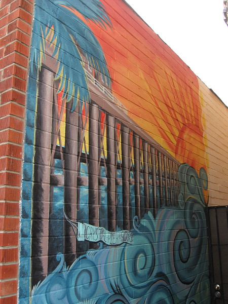 Mural in a narrow alley celebrates 90 years of Crystal Pier.