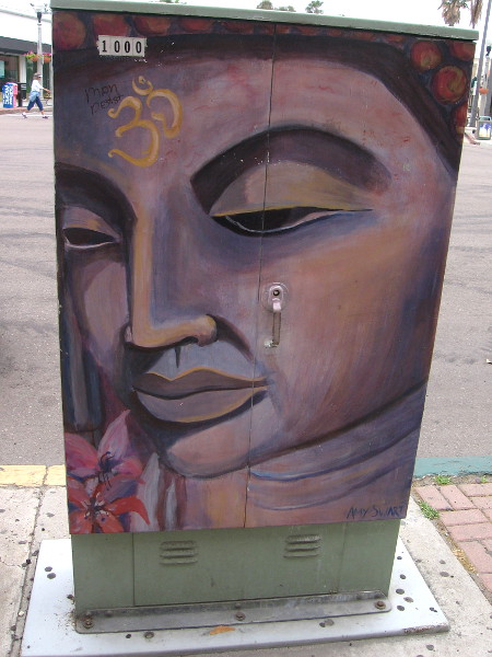 A beautiful, serene face painted on a utility box on Prospect Street in La Jolla.