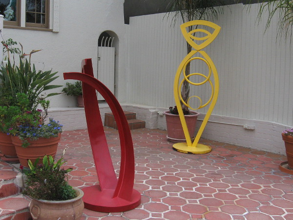 Two of five colorful sculptures, on a patio in front of 1261 Prospect Street.