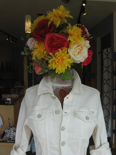 A flowery head in the window at Robina Apparel and Accessories.