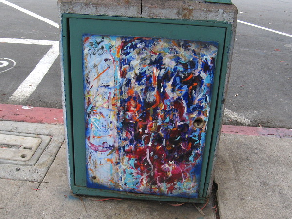 More trashcan street art. This painting is wildly colorful.