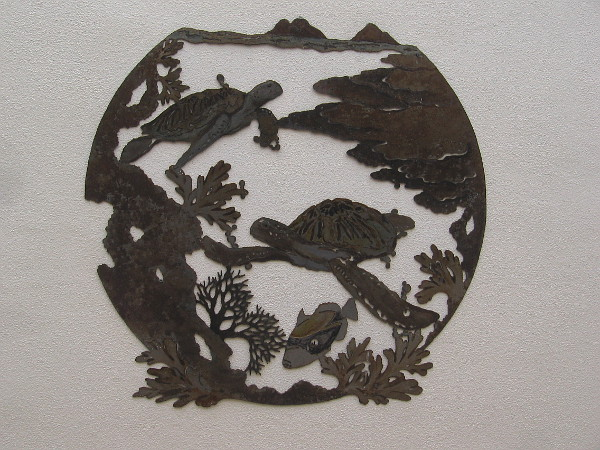 I walked down the outdoor corridor of the Arcade Building and found two pieces of beautiful metalwork. This one is alive with turtles and a fish.