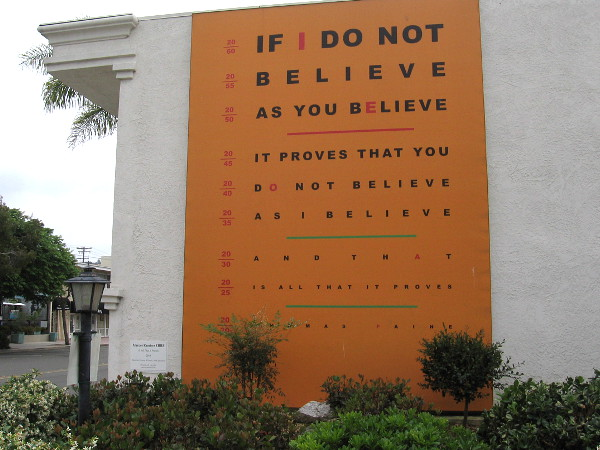 Is All That it Proves, 2015, by artist Marcos Ramirez ERRE. Thomas Paine's famous quote as an eye exam chart, asserting opinion is simply opinion.