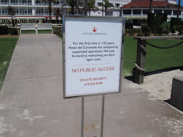 Sign states that for the first time in 132 years, Hotel del Coronado has temporarily suspended operations.