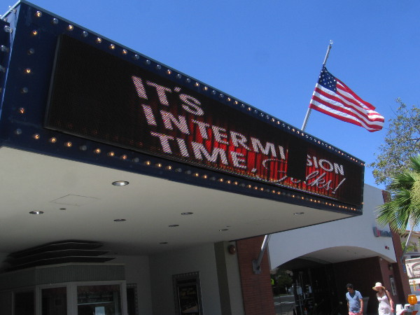 The marquee at the Village Theater indicates It's Intermission Time!