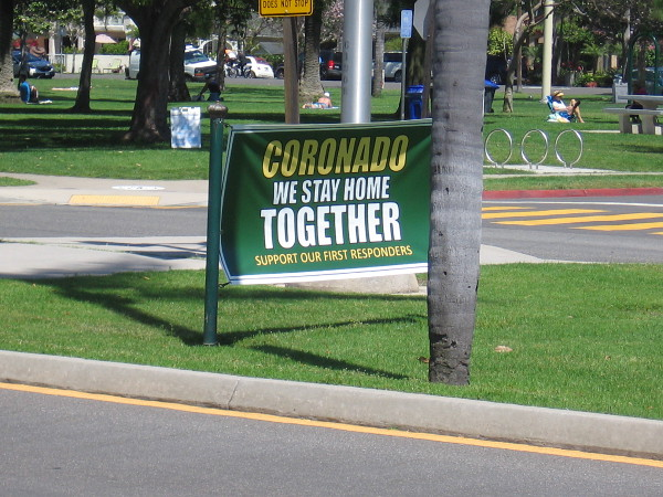 One banner on the Orange Avenue median near Spreckels Park says Coronado We Stay Home Together. Support Our First Responders.