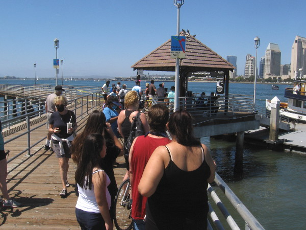 The Coronado ferry will depart for downtown San Diego shortly. I stayed at a distance from the group ahead of me. They were told to don masks before boarding the ferry.