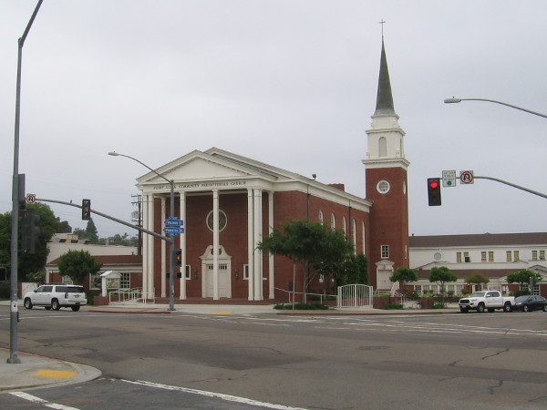 Looking at Point Loma Community Presbyterian Church from the intersection of Voltaire Street and Chatsworth Boulevard. The traditional New England style Red Brick Church was built in 1954.