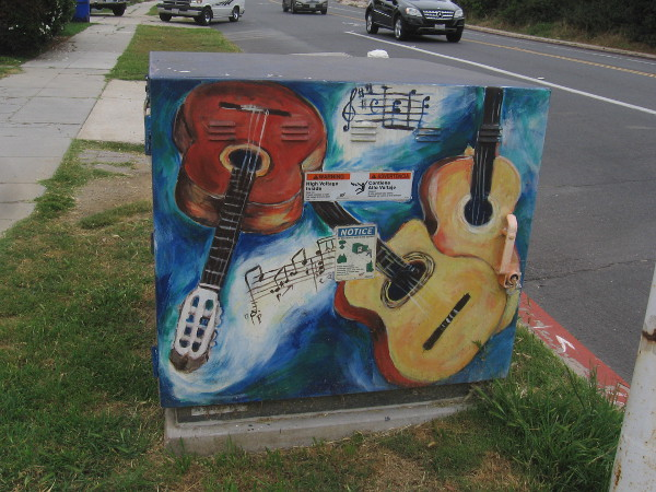 An electrical box up the street was painted with all sort of guitars.