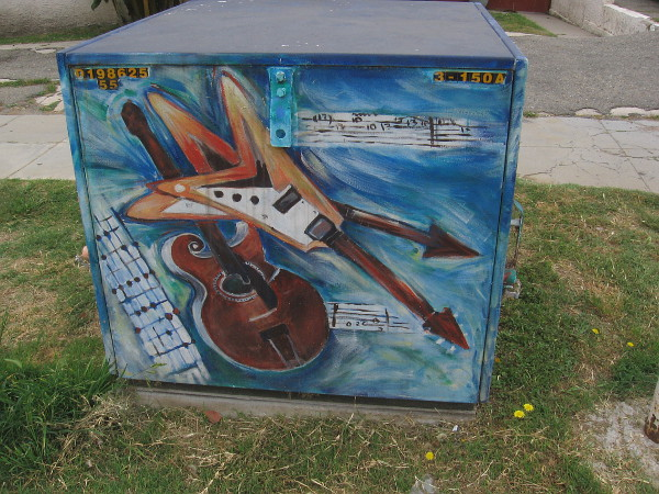 More colorful guitar street art on another side of the box.