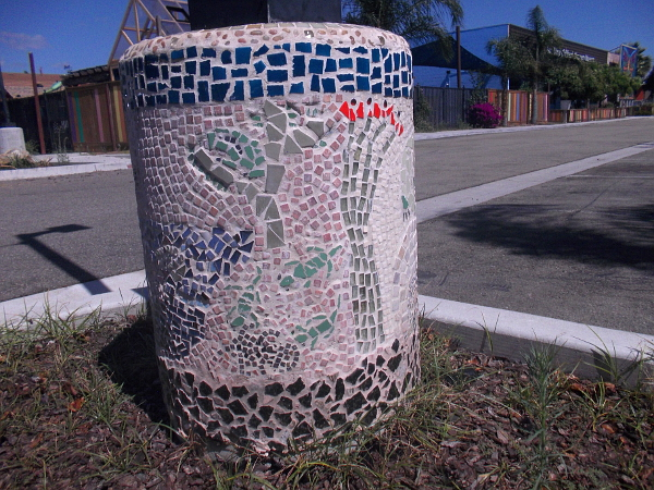 Mosaic on this post at the parking lot of the San Diego Children's Discovery Museum shows desert animal and plant life.