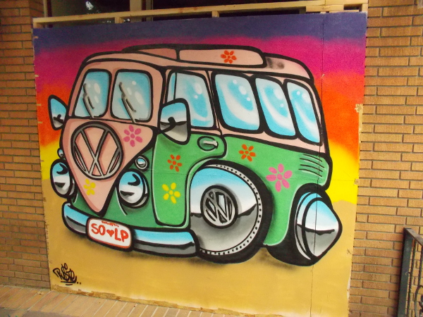 A flowery Volkswagen Hippie Van recalls the 1960's.