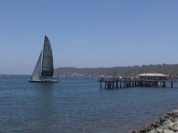 The huge Stars and Stripes racing yacht is passing the Shelter Island Pier. I haven't seen it on the bay for a very long time.